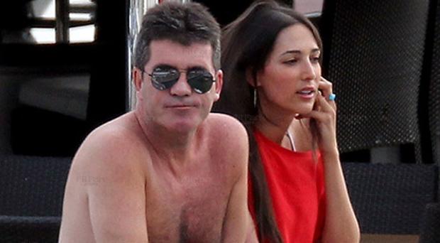 حكم إكس فاكتور سايمون كاول في إنتظار أول أبنائه من زوجة صديقه