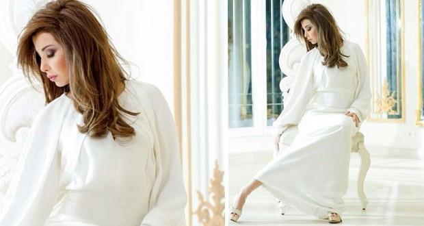 نانسي عجرم إلى باريس من أجل أسبوع الموضة وغلاف ألبومها يفترش الطرقات