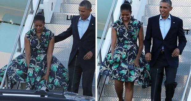بالصور: أوباما يُنقذ زوجته من موقف محرج على درج الطائرة